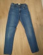 jeansowe spodnie z gumką 140 dziewczęce...