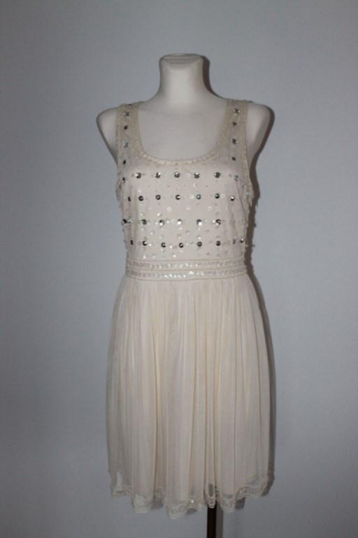 Jasna kremowa beżowa nowa sukienka z siateczką