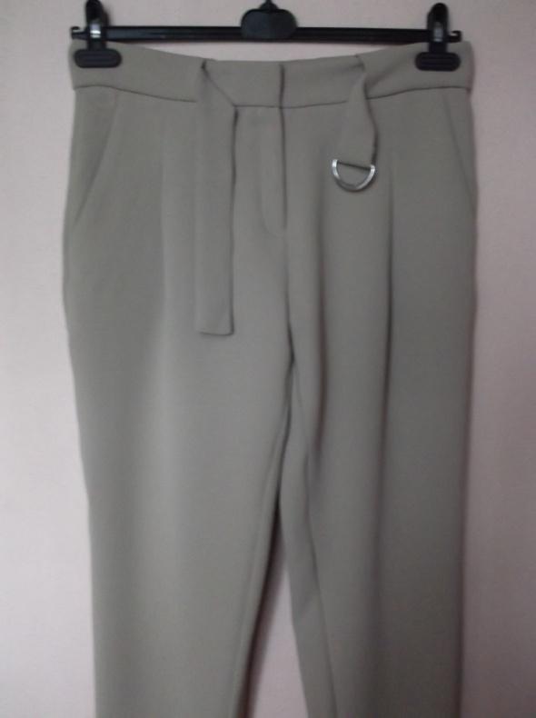 Beżowe spodnie Mango 38