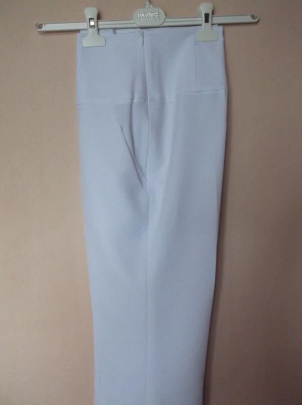 Białe spodnie cygaretki Nowakowska 38