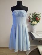 rozkloszowana niebieska sukienka...
