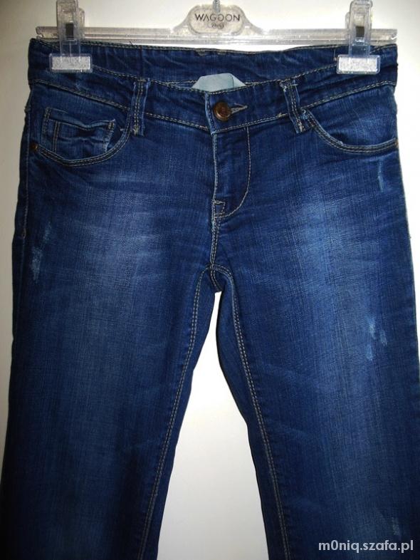 Granatowe jeansy 36
