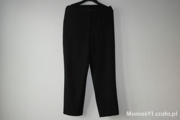 eleganckie czarne spodnie w prążki r 46...