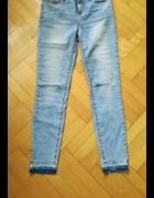 Jasne jeansy z dziurami poszarpane 2732 36...