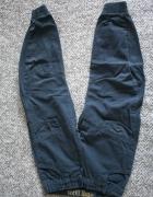 Spodnie granatowe joggery REBEL 110 116...