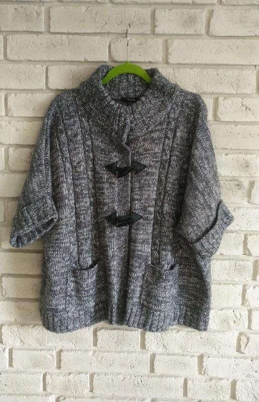 Melanżowy sweter z kieszeniami 46 48 50