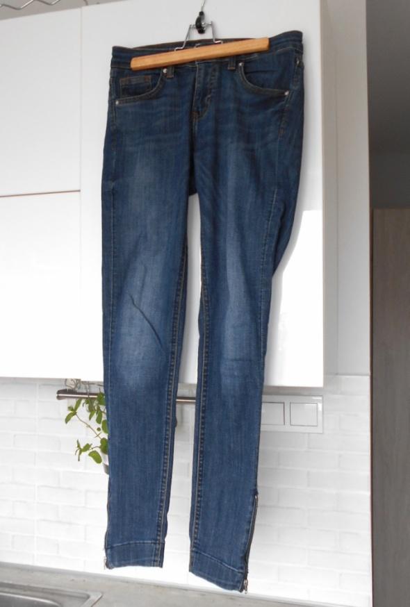 HM klasyczne jeansy rurki zamki zip