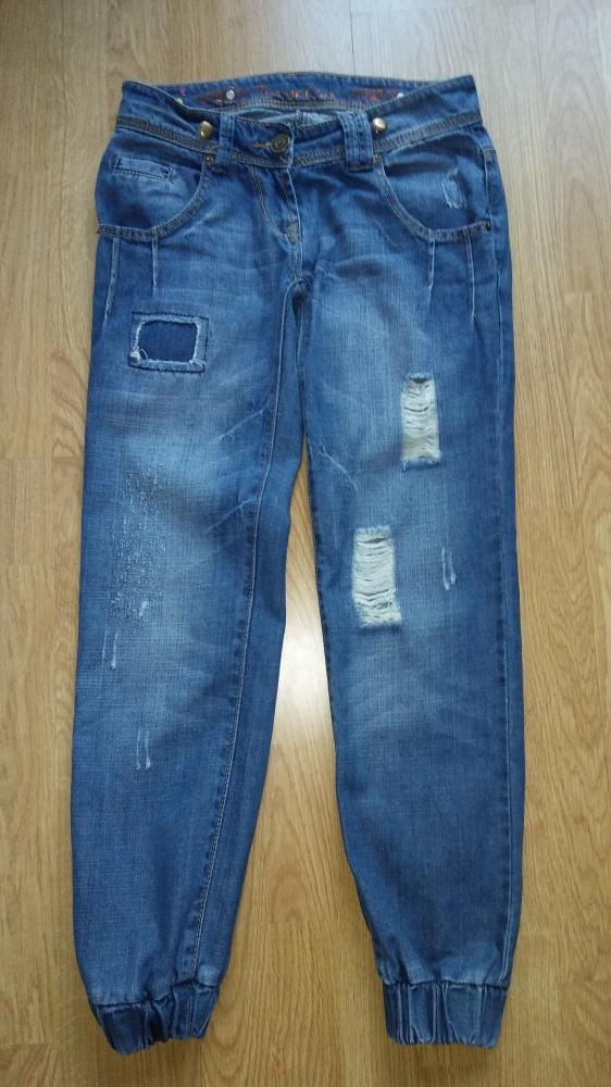 Spodnie jeansy dziury przetarcia