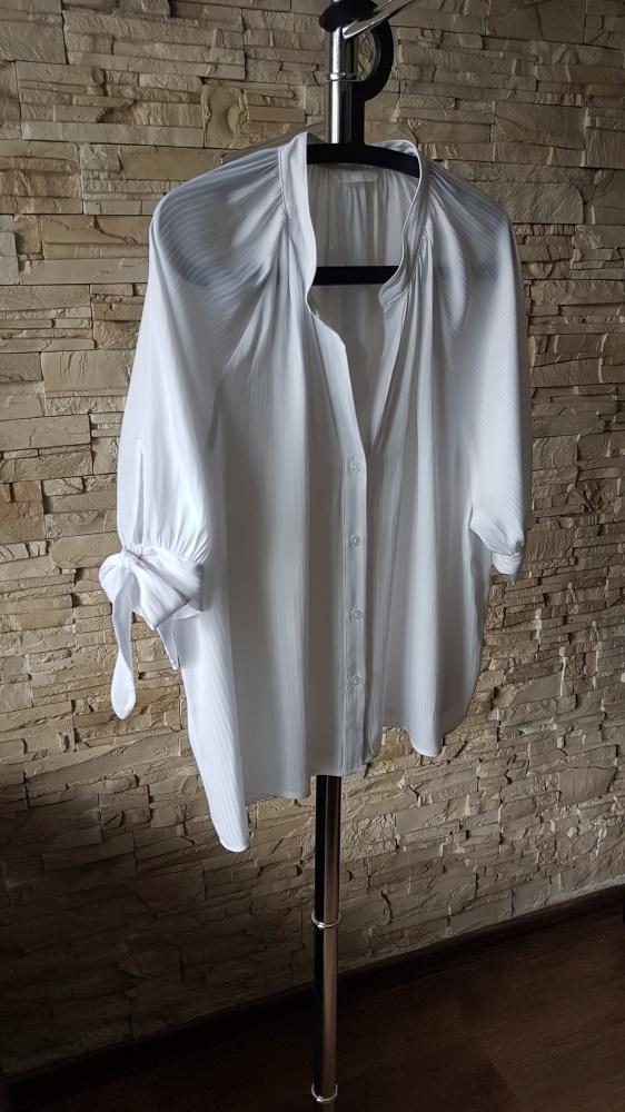 Biała bluzka H&M...