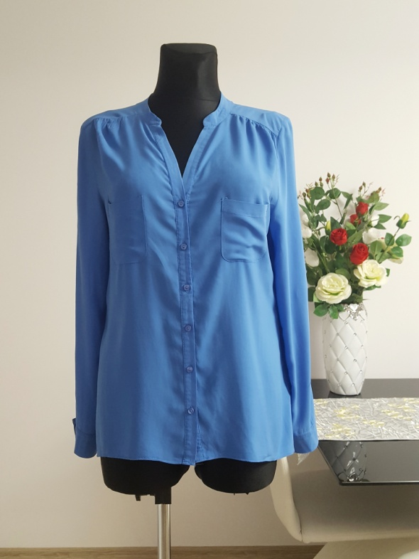niebieska bluzka z kieszeniami Atmosphere...