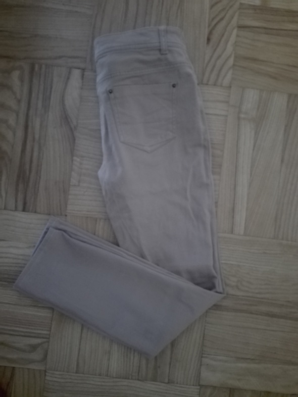 Beżowe spodnie Denim Co...