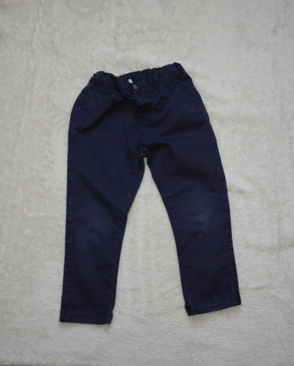 Spodnie i spodenki Chłopięce spodnie ciemny granat 98