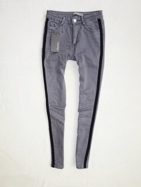 szare spodnie rurki z czarnym paskiem z boku 36 S