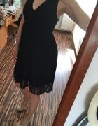 Czarna plisowana sukienka H&M...