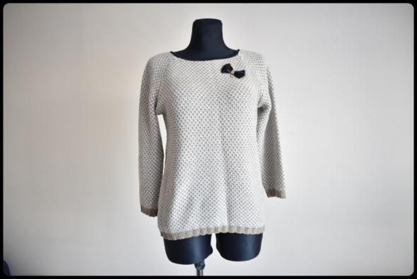 Piękny sweter z ozdobną kokardką 40 L beżowy miękki i miły