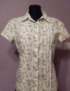 Biała bluzka koszulowa w zielone liście z krótkim rękawem i koł...