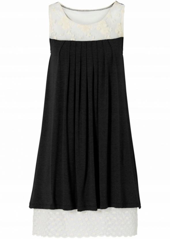 Kremowo czarna sukienka z koronką...