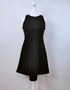 12 40 L Atmosphere Czarna trapezowa sukienka...