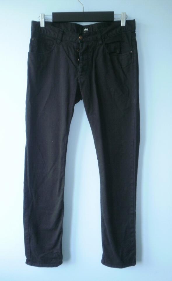 HM czarne męskie jeansy spodnie