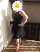 Sukienka czarna asymetryczna ze złotymi cekinami r 48...