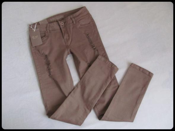 Spodnie NOWE z metką spodnie rurki z przetarciami 40 L
