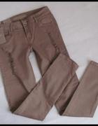 NOWE z metką spodnie rurki z przetarciami 40 L...