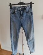 Marmurkowe spodnie z wysokim stanem Reserved...