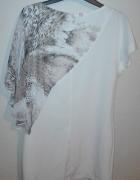 Piękna sukienka roma z panterka...