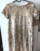Złota sukienka Zara...