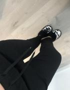 Czarne H&M 40 L ciepłe podszyte na gumce eleganckie spodnie mat...