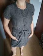 Jeansowa sukienka zapinana na guziczki...