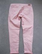 spodnie jeans rurki LEVIS W32 łososiowe...