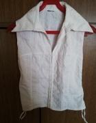 Biała bluzka bez rękawów...