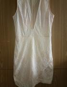 Sukienka koronkowa marki Missguided z wycięciem z przodu...