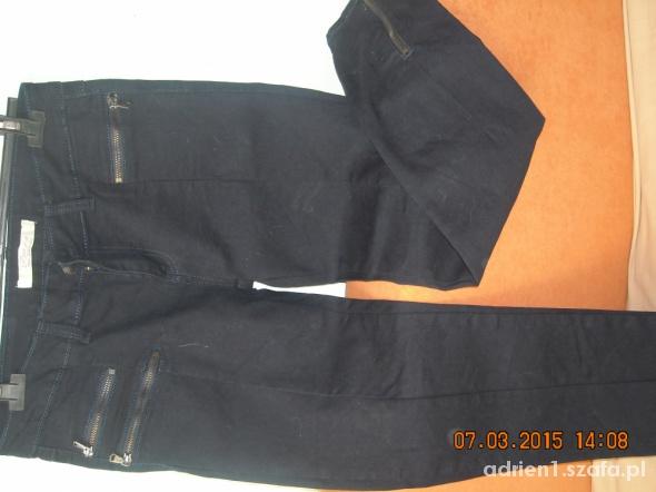 Jeansy z zipami 38 na 40 granatowe