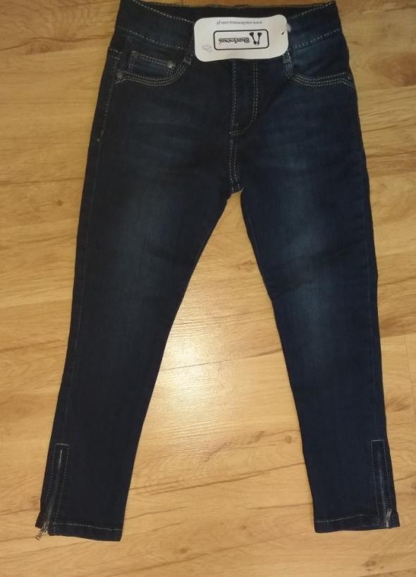 Nowe jeansy spodnie z zipami rozm 18 116...