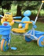 Rowerek trójkołowy z prowadnikiem i koszyczkami