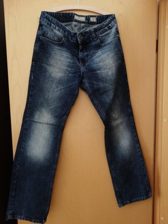Męskie jeansy Rozmiar W31 L32 House
