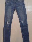 Spodnie jeansowe z dziurami slim CROOP XS...