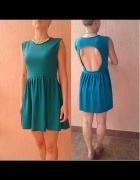 Szmaragdowa rozkloszowana sukienka opkryte plecy...