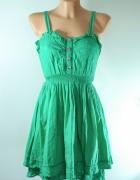 Zielona rozkloszowana sukienka...