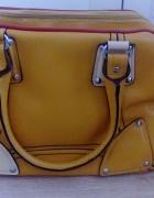 Duża solidna żółta torba podróżna...