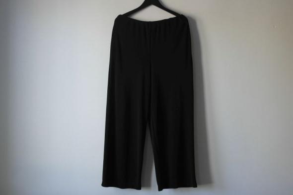 czarne elegankie spodnie na gumie r 42