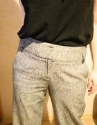 Szare eleganckie spodnie damskie...
