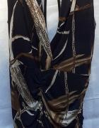 Oryginalna tunika z dużym dekoltem i wiązaniami...