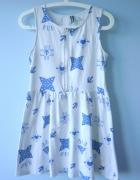 HM rozkloszowana sukienka wzory aztec zip zamek...