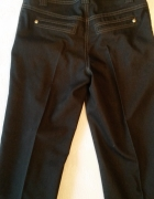Granatowe spodnie Orsay 32 XXS...