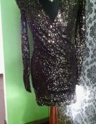 Błyszczaca sukienka bufki dekolt 36
