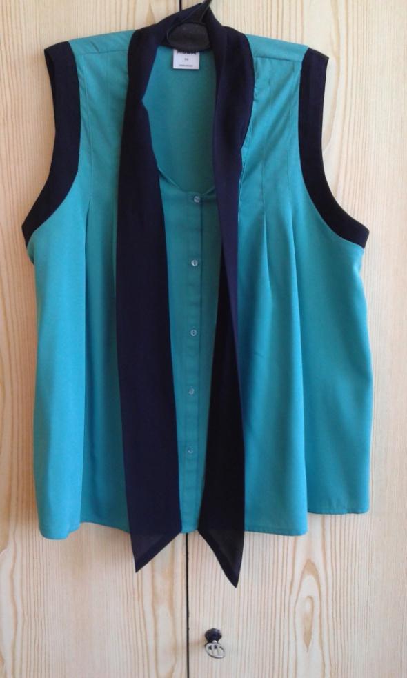 Bluzki Zielona bluzka z czarną kokardą XS 34 Vero Moda