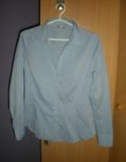 Niebieska koszula z długim rękawem...